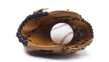 Baseball glove and ball isolated on white background.