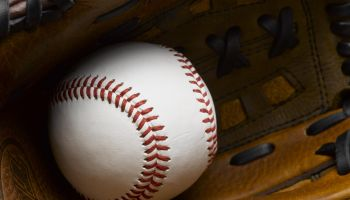 Baseball in glove close-up