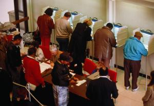 Voters in booths at election, elevated view