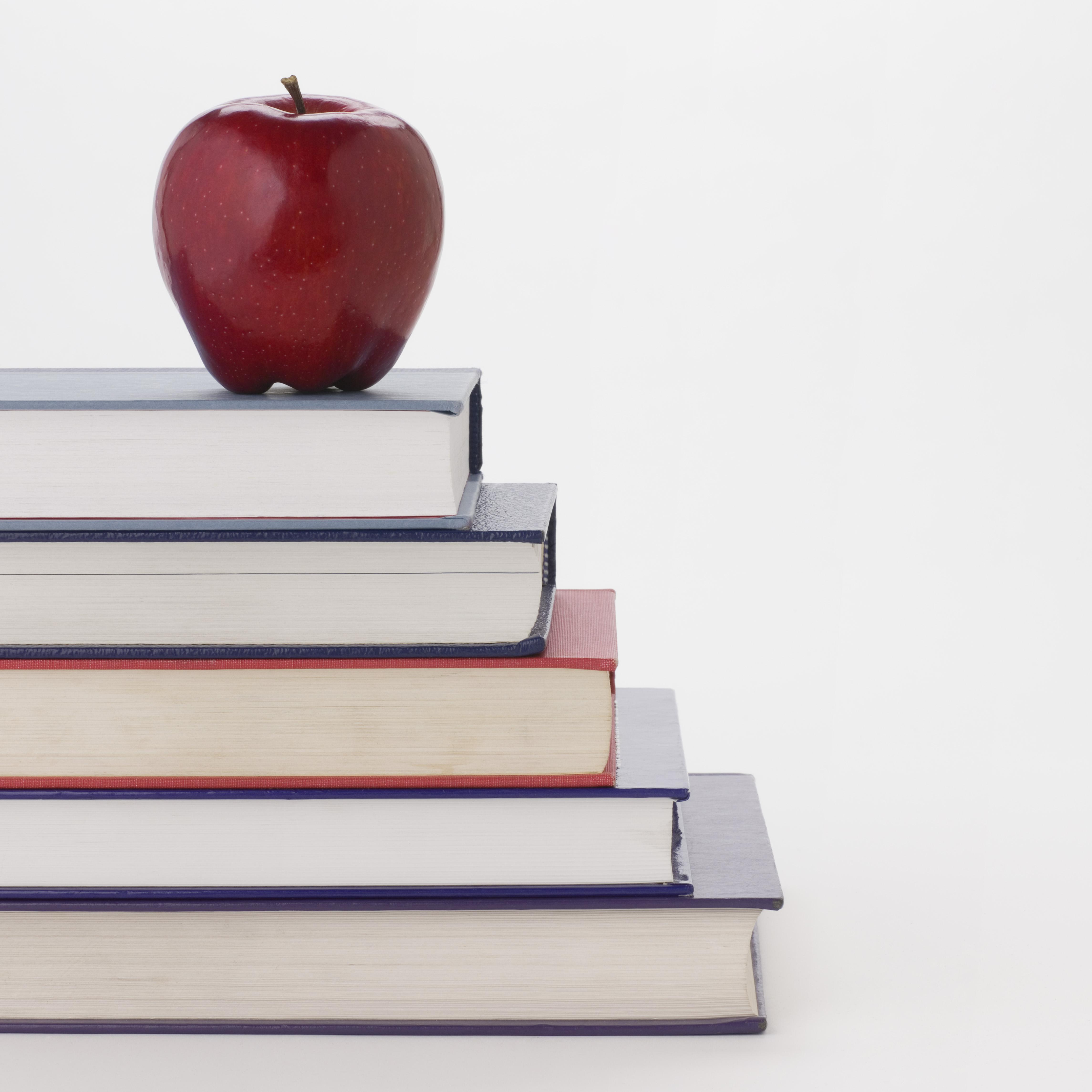 Apple and stack of books