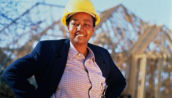 Woman wearing hard hat, portrait