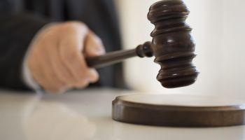 Judge holding gavel, close-up