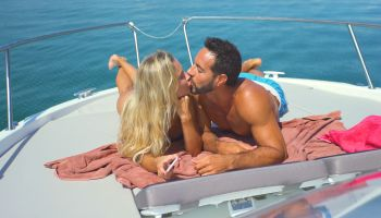 Beautiful young couple relaxed in yatch kissing