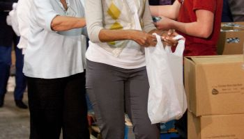 Michelle Obama and Dr. Jill Biden Volunteer for Feeding America