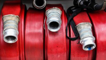 Red fire hoses on a fire engine