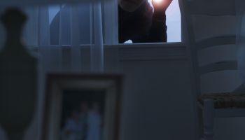Thief peering in a window