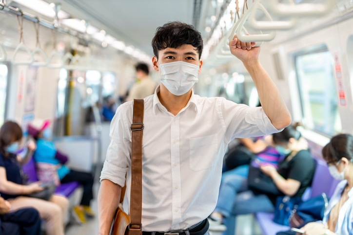 man with mask in metro